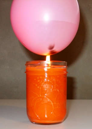 The water absorbs the heat of the candle. The baloon doesn't explode.